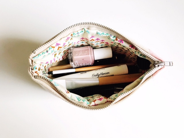 color block bag with makeup products inside