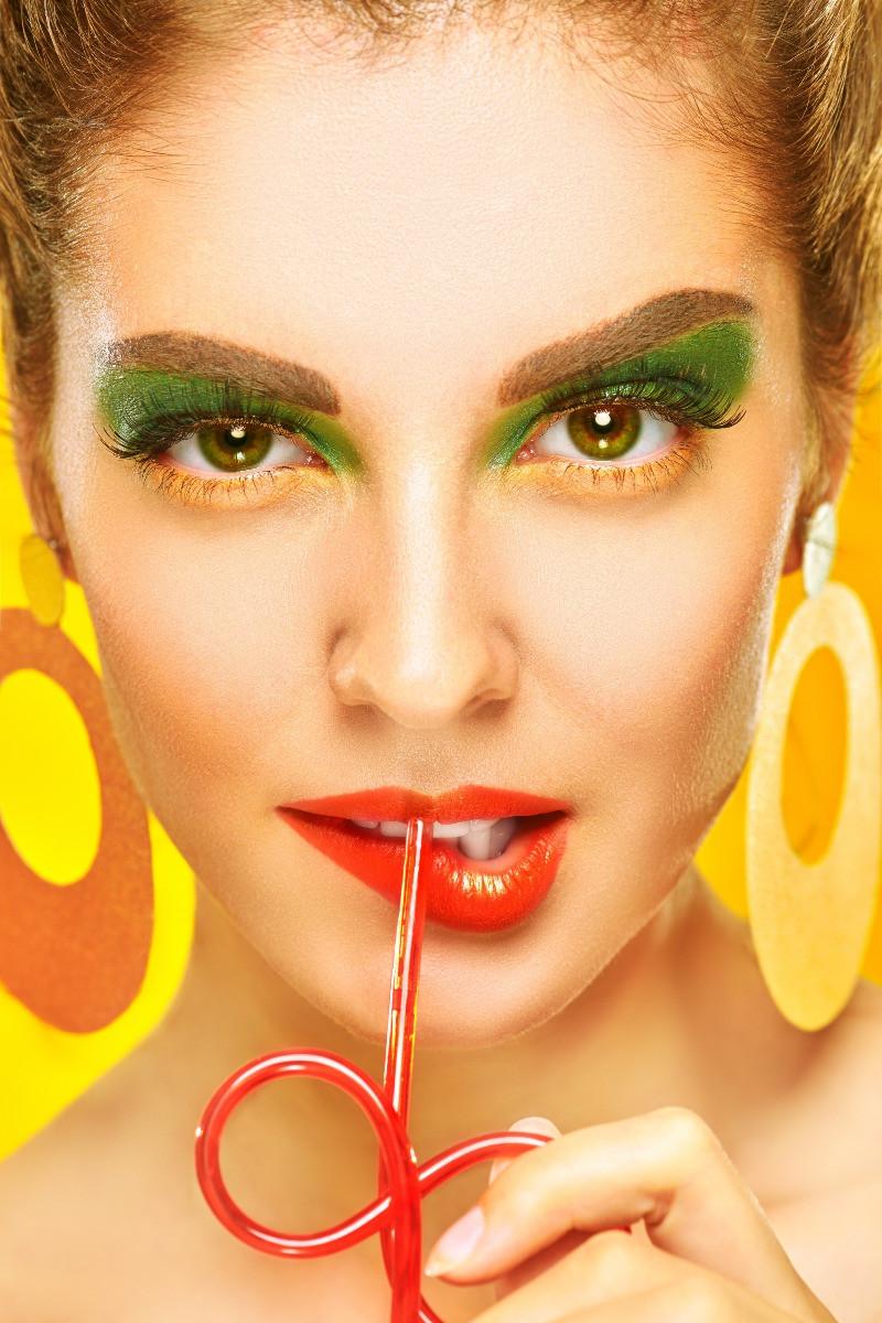 green and yellow eye makeup on woman