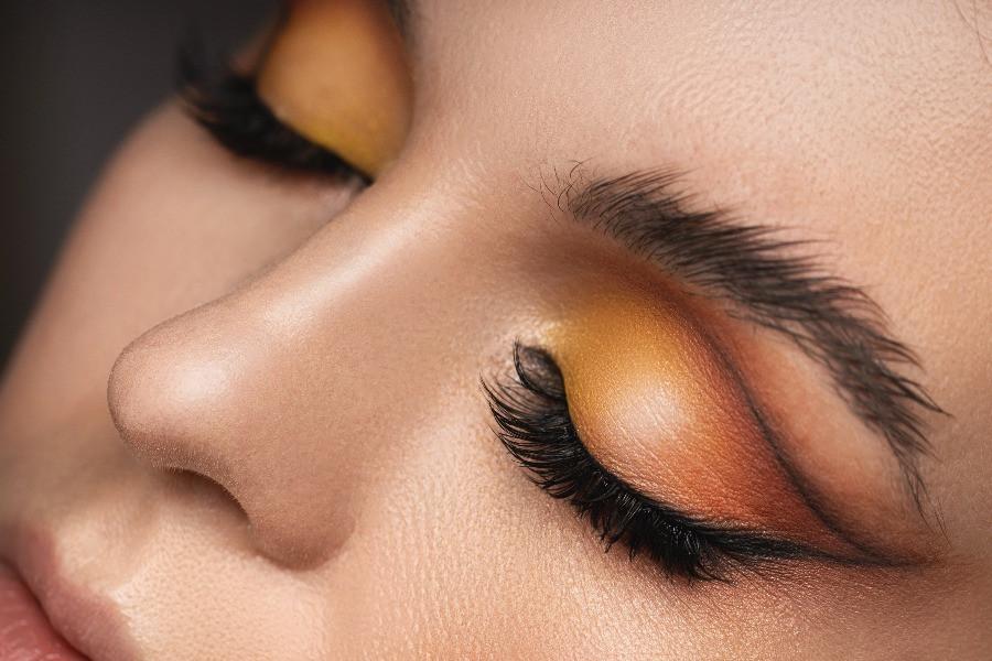peach and yellow eye makeup on woman