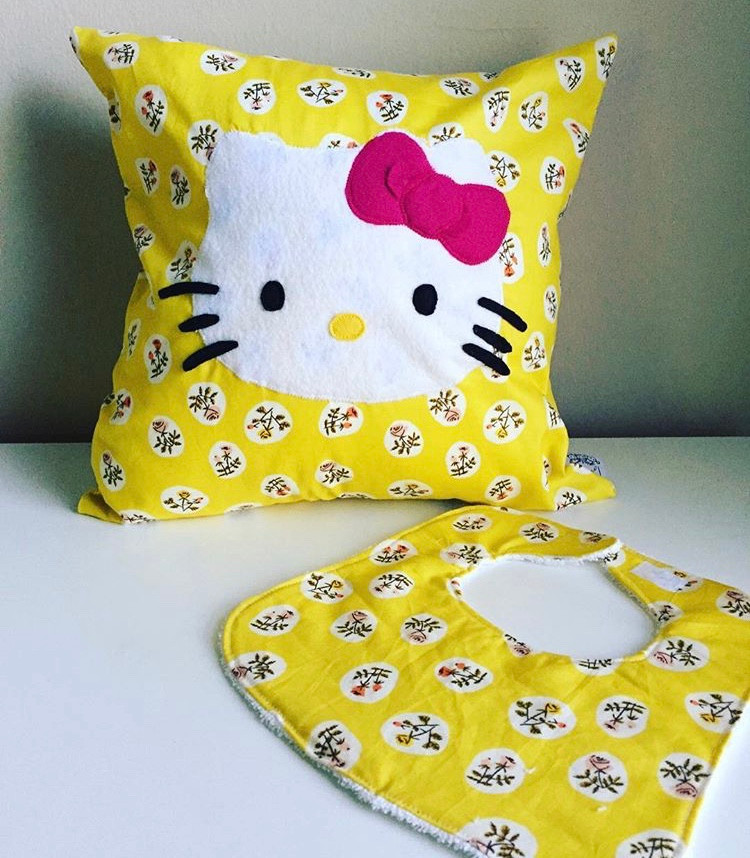 baby girl bib and hello kitty fabric pillow