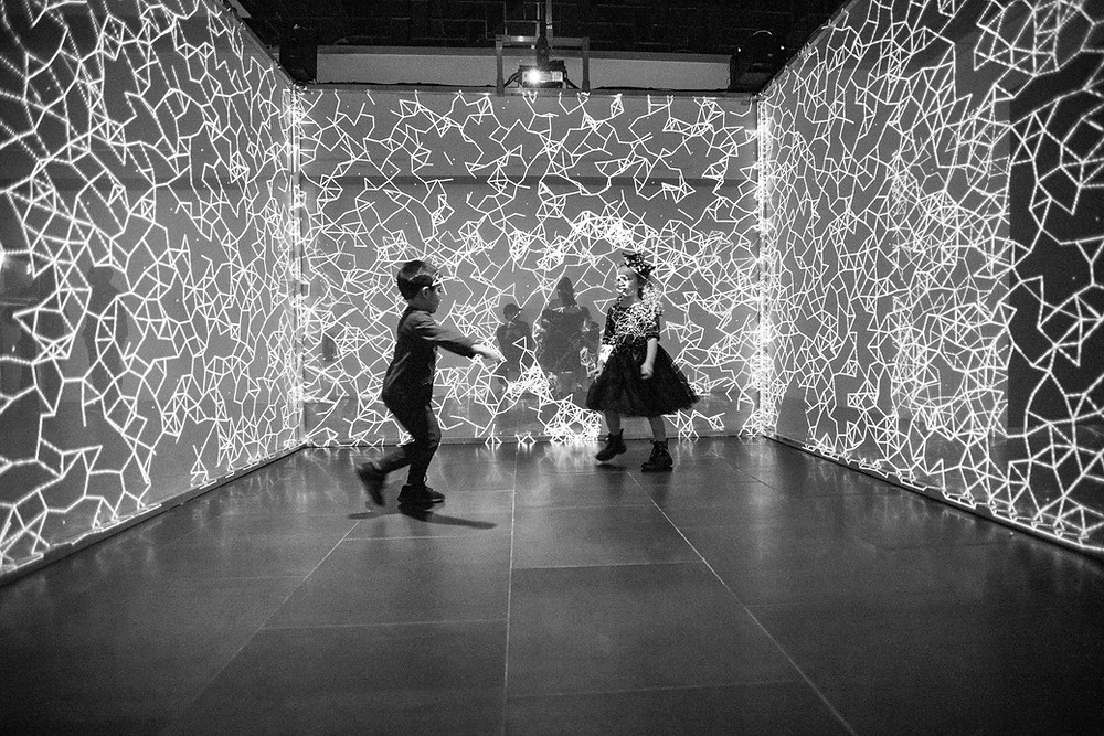 Children interacting with Abstract Landscapes light installation