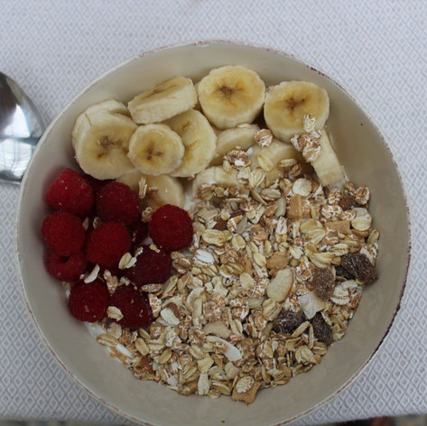 Raspberries from the garden with banana, muesli and yoghurt, served with fresh honey.