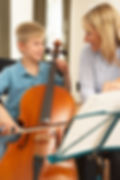 Boy playing cello in music lesson.jpg