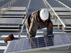 DCCU celebrates 13th branch, renewable power agreement