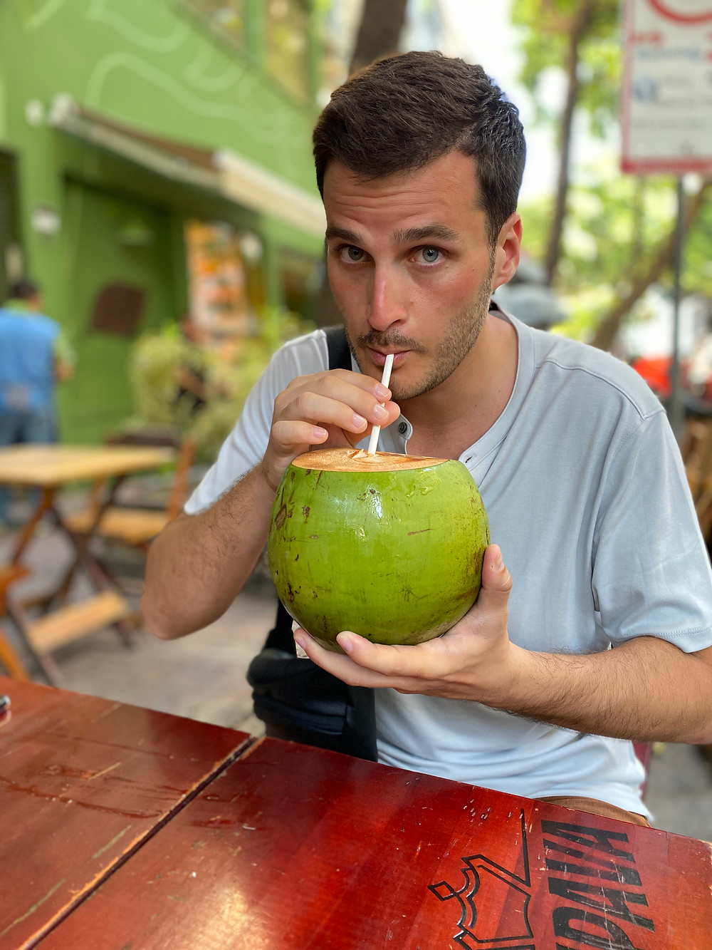 Enjoying a refreshing dose of coconut water in Rio