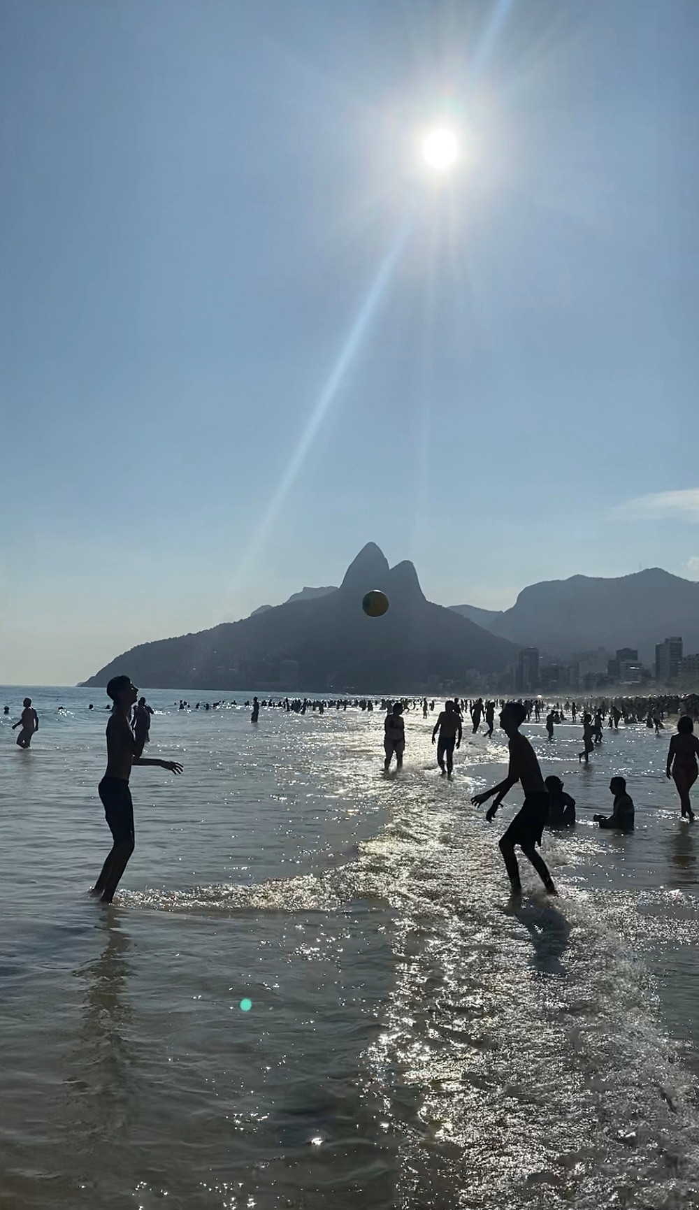 Locals playing in the water at Copacabana Beach