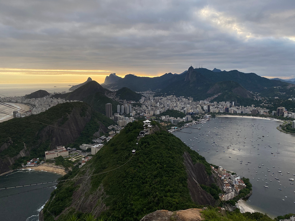 As the sun sets, the beaches and the mountainous background will look as if gigantic dark waves were coming to crash on Rio.