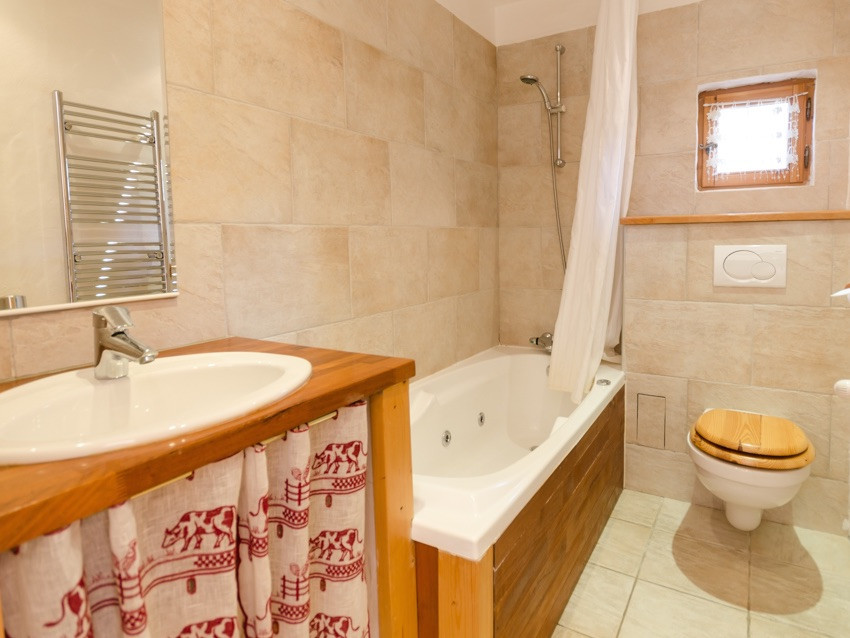 Natural stone tiled bathrooms some with