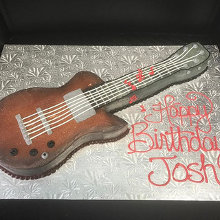 Guitar cake for the talented musician or