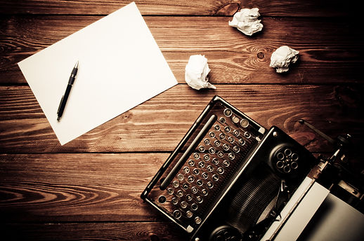 Vintage typewriter and a blank sheet of