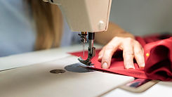 close-up-hands-sewing-with-machine.jpg