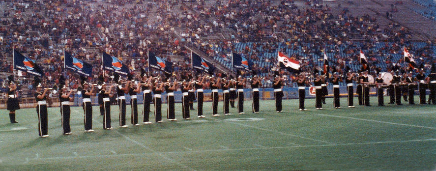 Does anyone remember anything about this show? The corps is in their t-shirts and it looks like they're carrying Seneca College flags as well as Toronto Argonaut flags.  Presumably, it was at an Argo game.  Photo submitted by Mark Decloux