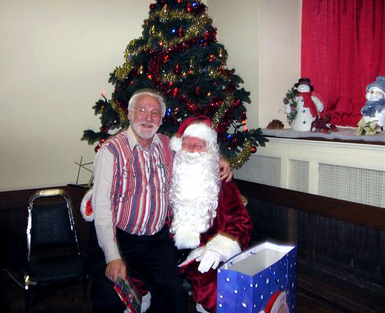 Dave Kirton on Santa's knee  Photo submitted by Phil Hennings