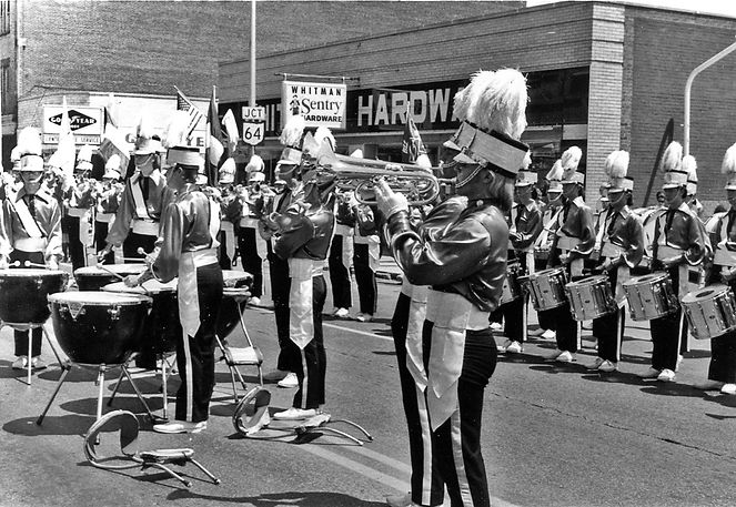 The tymp players from left to right are Rob Scott, Jim Kane, Randy Cochrane, Ted Butson and Ray Skyvington. The two French Horn players are Randy Albertson (foreground) and Paul Coffey.  Photo by Don Daber