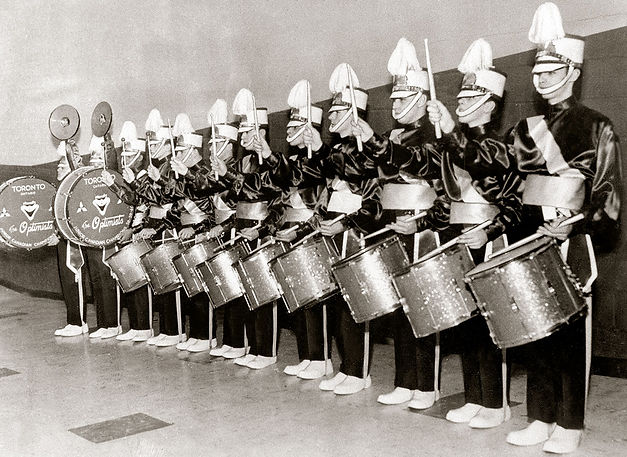 6 snares plus 3 tenors was a very big drumline in 1960! Most corps carried 3 & 3.  L-r: Glen Durish, Glenn Copp, Hector Roberts, Colin Hedworth, Carl Clutchey, Gord O'Halloran, Jim Reynolds, Bob Anderson, Bill Ukas, Brian Williams, Ronn Prokop, Harry Clark  From Colin Hedworth's collection
