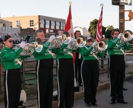 Some of Optimists Alumni horns warming up before parade (Rochester, 2014)