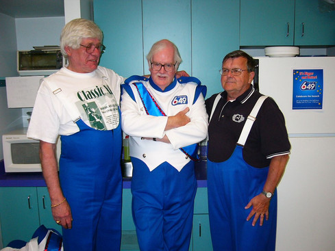 Frank Rivier, Bob Keenan and Tery Sweeney, Optimists Alumni dressed for Lotto 6/49 promo (2004)