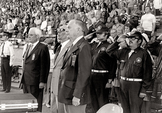 Robert Stanfield, Leader of the Opposition, and Mr Baggs standing for National Anthem (Nationals, CNE, 1972)