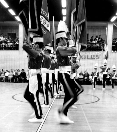 They are carrying the 1969 Natinal Champion Circuit Guard flag and the two fellows at the front are John O'Leary (right) and Chris White (left) who was a rookie in 1970.  Photo Submitted by Ric Brown