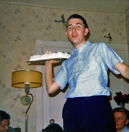 The photo was taken at Don Norman's (guard) house after the 64 or 65 nationals, his mom had baked the cake to celebrate our winning. 