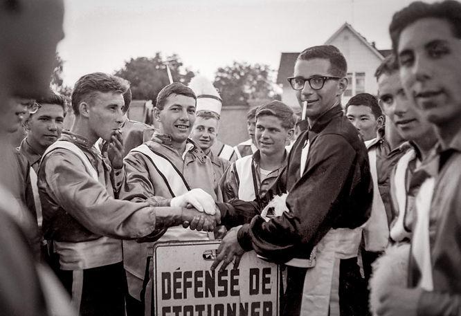 John Diamond & Bill Grigg present a French 'no parking' sign to Al Brinker, Cavaliers DM (Menominee, MI, 1964)