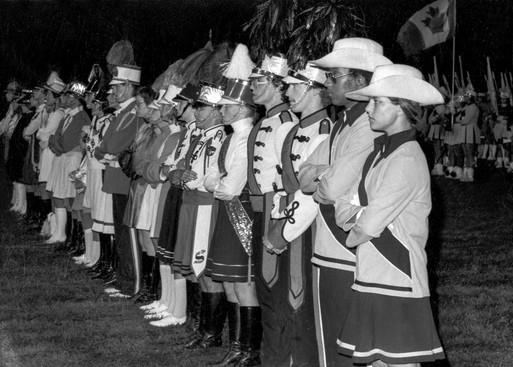 3rd & 4th from right are Optimists DMs, Mike Arsenault and Mike Williams: Drum Majors on retreat (Nationals, 1975)