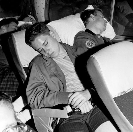 Mike Thys sleeping on a bus trip (1963 or 64)