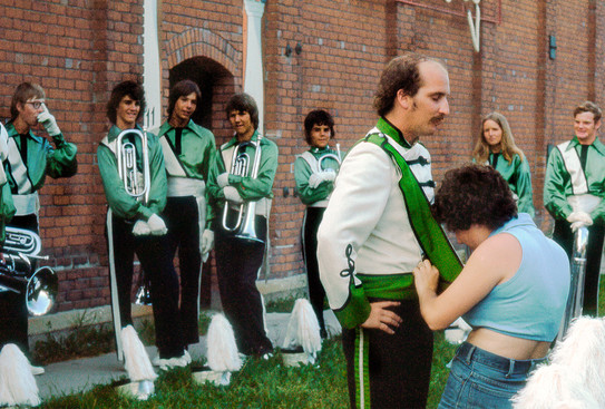 Peter Byrne being dressed as Drum Major, Toronto Optimists (Brantford, 1975)