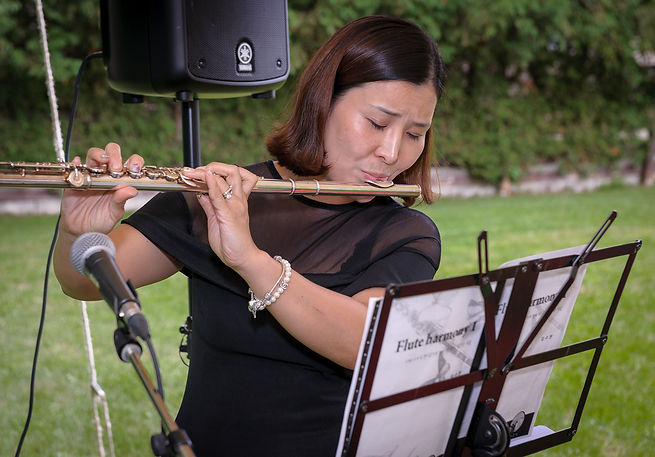 Yun serenading us with her flute (End of Season BBQ, 2016)
