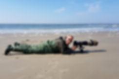 Henk strand Texel bij Cocksdorp om Drieteenstrandlopers te fotografern.