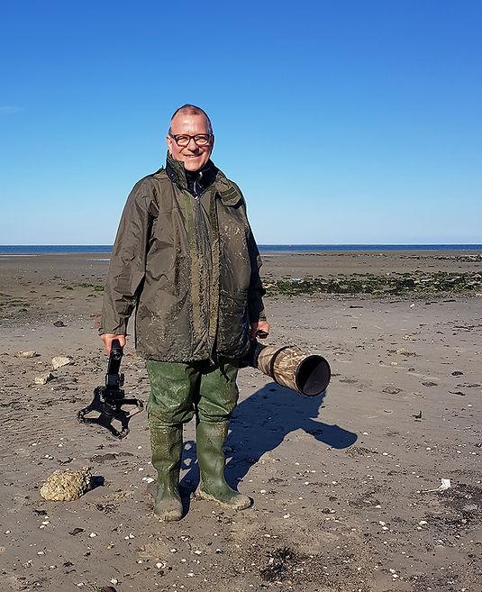 Zo kwam ik terug nadat ik de Rosse Grutto's had gefotgrafeerd door plat op het slik te gaan liggen bij Texel in de buurt van de Vuurtoren.
