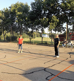 People playing Pickle Ball at the Gull Lake Pickle Ball/Tennis Courts.