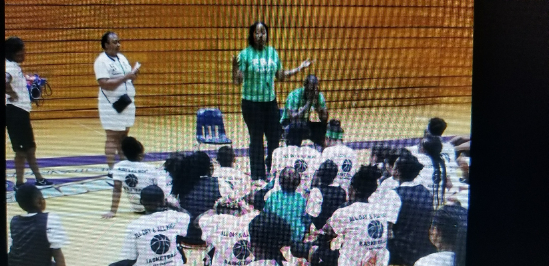 Coach Dee speaking to campers