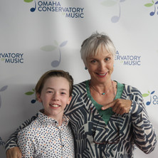 My orchestra conductor for two years - Patty Ritchie (Omaha Area Youth Symphony). She's always inspiring.