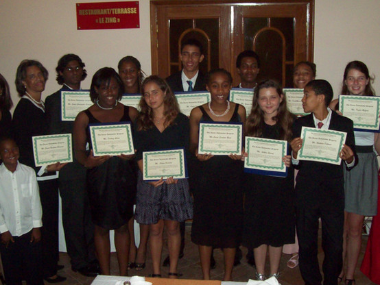 Junior Ambassador Teen Leadership Program being affirmed by U.S. Ambassador Marcia Bernicat (on the left), and the Malaysian Ambassador Senegal (in the Red Gown).