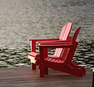 red-wooden-lounge-chair-on-brown-boardwa
