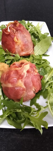 Fig stuffed with goats cheese and wrapped in parma ham