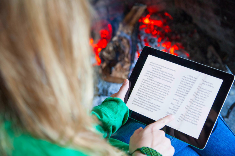 Reading on Tablet canstockphoto18339591.jpg