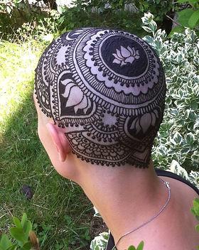 Detailed henna on a head.
