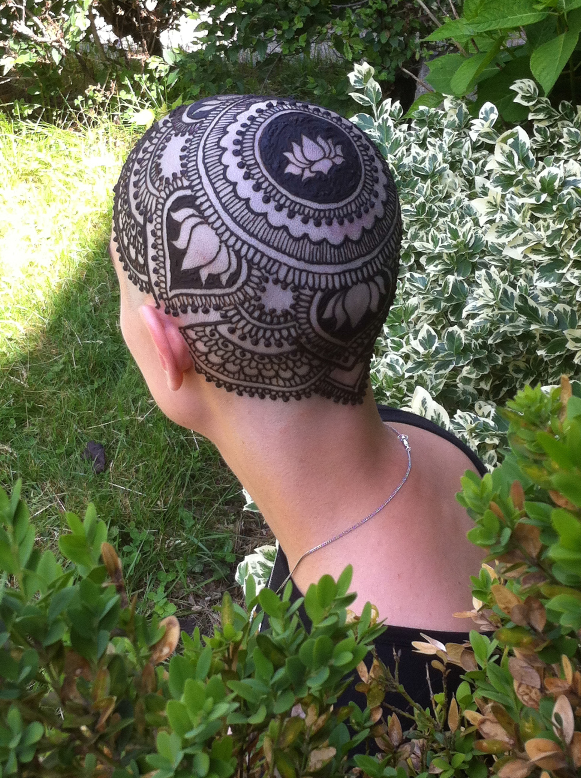 Henna on the top of a head.