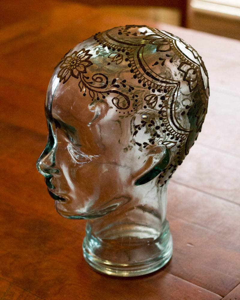 A glass head from Pier One Imports. Henna Crowns by Tarquin Sing of Henna Planet.