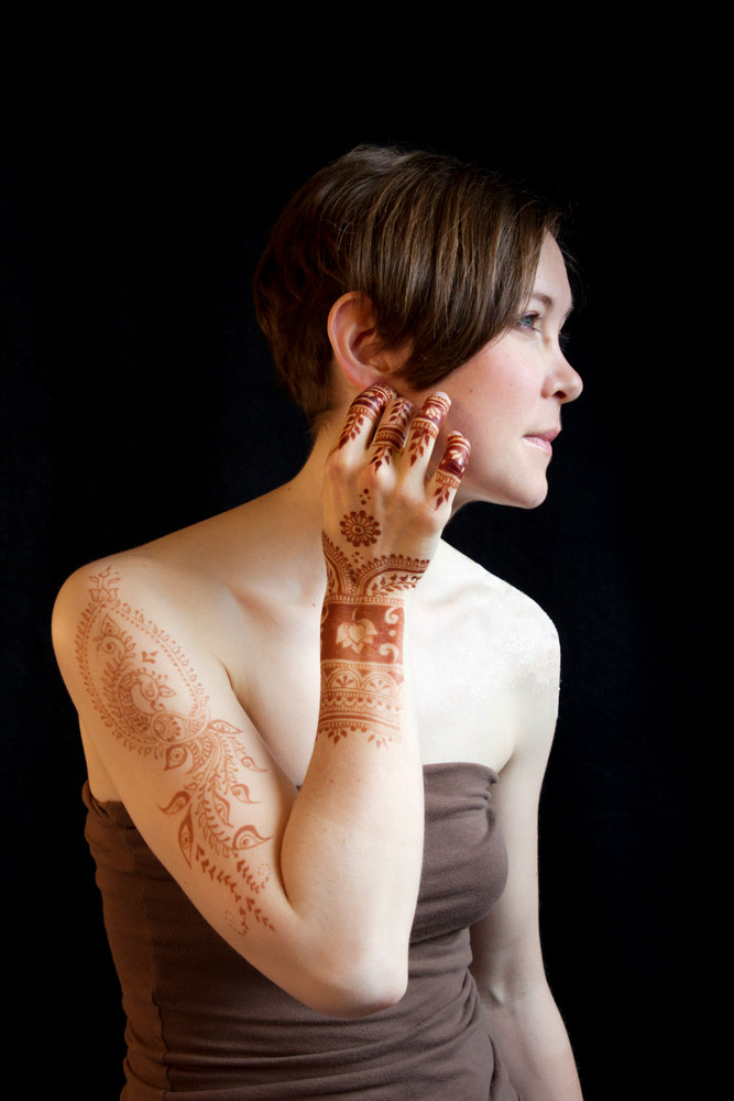 Henna on hand, arm, and shoulder.
