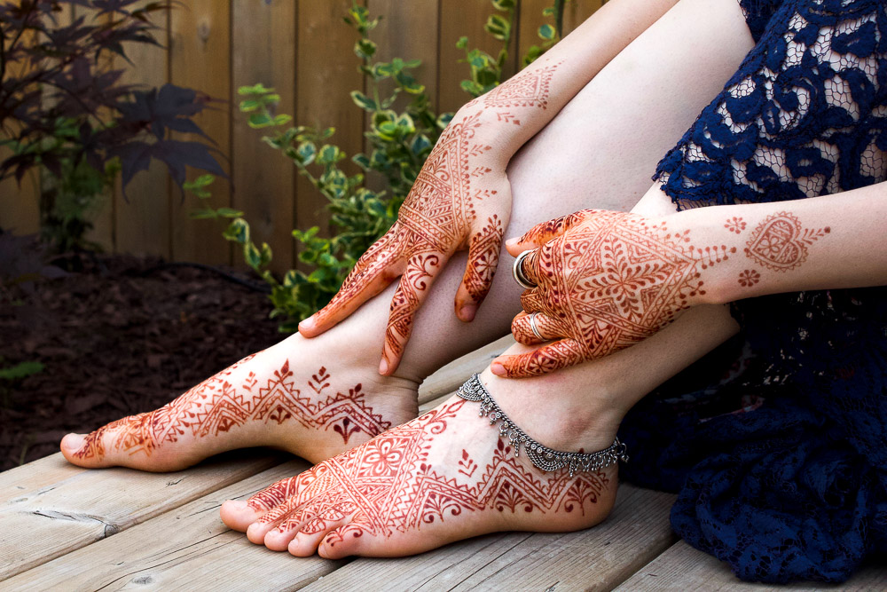 Moroccan henna on hands and feet.