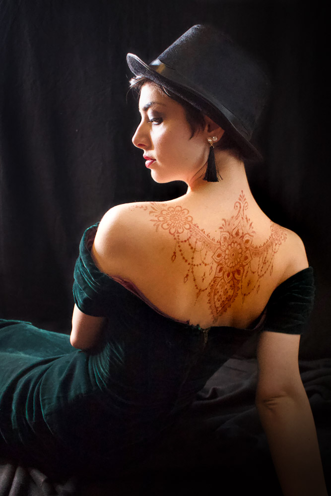 Woman with henna on her back.