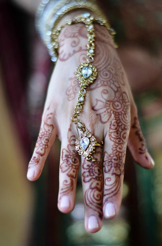 Bridal henna on a hand.