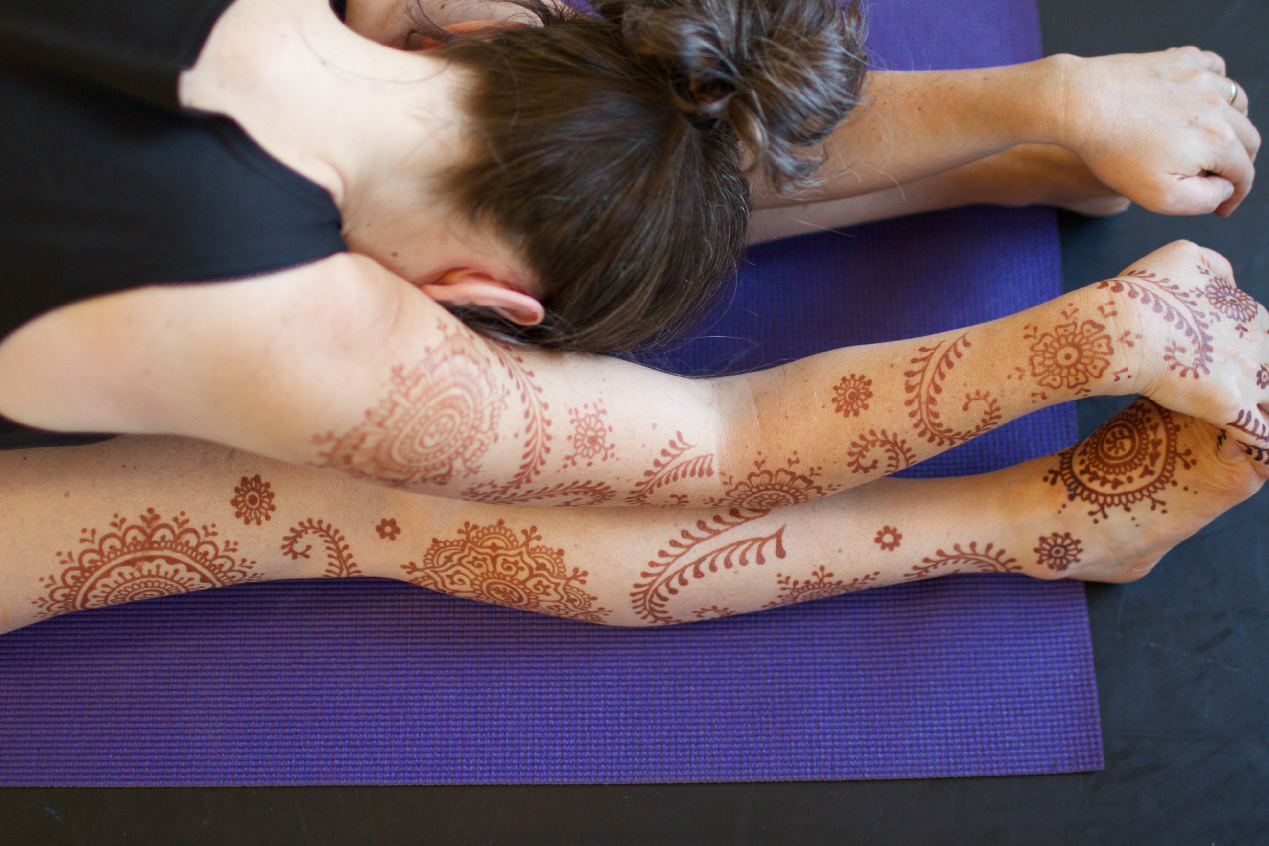 Henna and yoga pose.