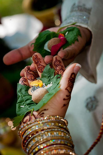 Bridal henna on the hands of a bride during her wedding ceremony, Toronto, Ontario.