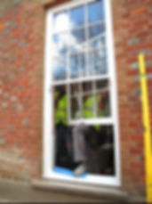 Fitting sliding sash windows.