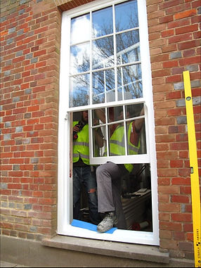 Fitting sliding sash windows.