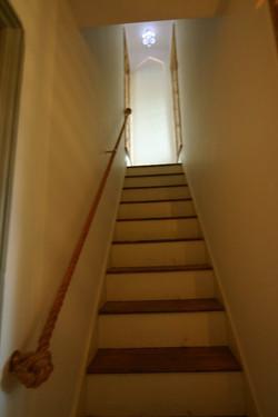 Manilla rope stairs hand rail.